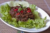 picture of hari raya  - Spicy beef rendang with cucumber and salad. Traditionally prepared by the Indonesian and Malaysian community during festive occasions such as traditional ceremonies, wedding feasts, and Hari Raya.