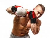 image of kickboxing  - Handsome muscular young man wearing boxing gloves - JPG