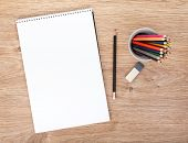 image of pencil eraser  - Blank paper and colorful pencils on the wooden table - JPG