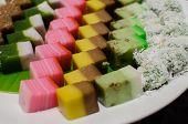 stock photo of malay  - Malay colourful traditional dessert on banana leaf