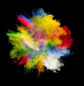 foto of paint spray  - Freeze motion of colored dust explosion isolated on black background - JPG