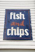 Weathered Fish And Chips Sign At Seaside poster