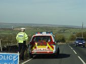 Police Car And Slow Sign poster