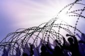 foto of human rights  - the barbed wire with clouds and sunblades - JPG
