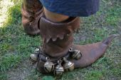 stock photo of bagpiper  - medieval leather boots with bells of the bagpipe musitian - JPG