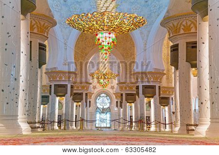 ABU DHABI, UAE - MARCH 26: Interior of Sheikh Zayed Grand Mosque in Abu Dhabi on March 26, 2014, UAE. Mosque has many unique elements like 12 tons chandelier covered by gold and Swarovski crystals.