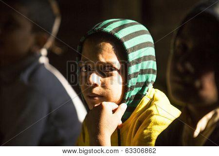 KATHMANDU, NEPAL - DEC 9, 2013: Unknown child in lesson at Jagadguru School. School established at 2013, to let new generation learn Sanskrit and preserve Hindu culture.