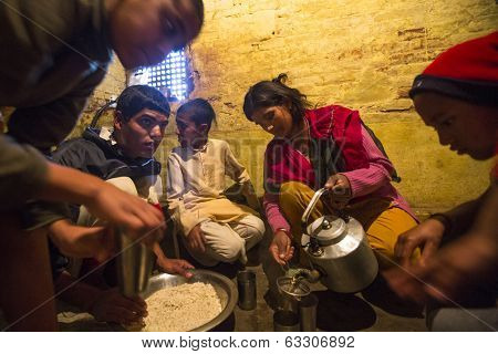 KATHMANDU, NEPAL - DEC 9, 2013: Unknown children during lunch at Jagadguru School. School established at 2013, to let new generation learn Sanskrit and preserve Hindu culture.