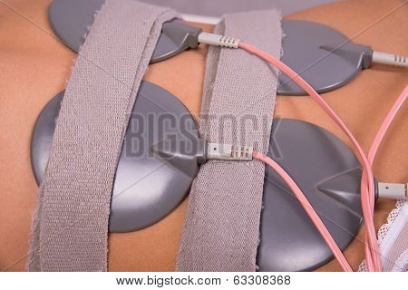 Electrodes on young woman
