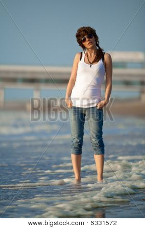 Young Girl Walking On A Beach