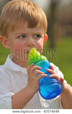 Adorable Little Boy Drinking Water