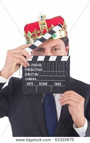 Businessman in king concept with movie board isolated on white