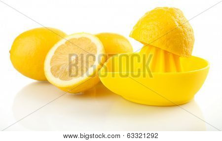 Citrus squeezer with lemons isolated on white