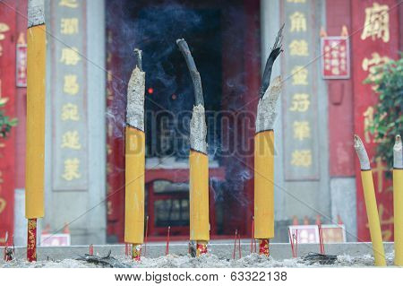 Smoldering Chinese Candles At Tam Kungtemple