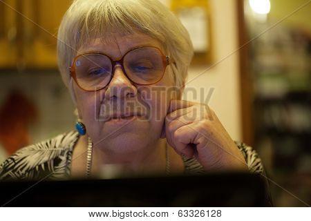 Modern elderly woman using skype