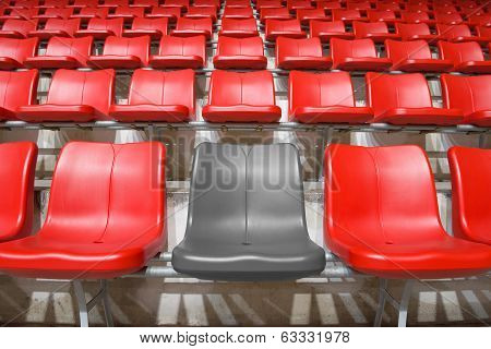 Grey Stadium Seat Between Red Seats