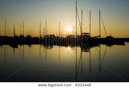 Boats in the Marina Silhouetted at Sunrise