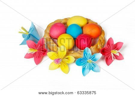 Many Easter eggs in a baked pigtail and colored paper flowers