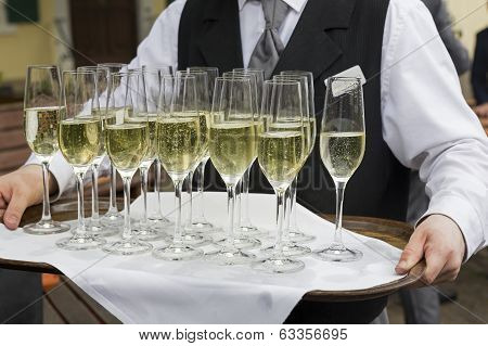 Glasses filled with champagne on a tray