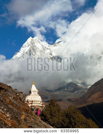 Stupa And Ama Dablam Between Clouds On The Way To Everest Base Camp - Nepal