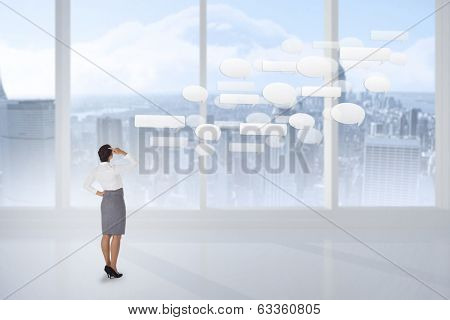 Businesswoman scratching her head against bright white room with windows