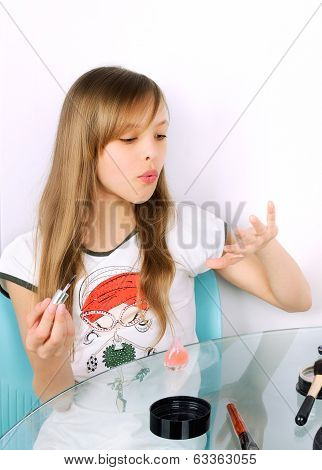 Teenager Girl Blowing On Painted Nails