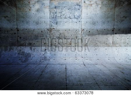 Grungy concrete wall and floor with rounded corners.