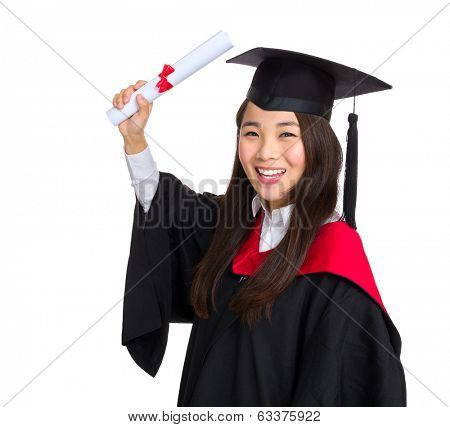 Happy graduate student girl in an academic gown with diploma
