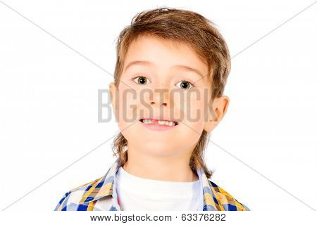 Little cute boy showing his hole from fallen milk tooth. Healthcare. Isolated over white.