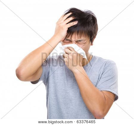 Sneezing and headache of asian man