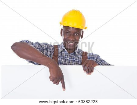 Repairman Holding Bill Board