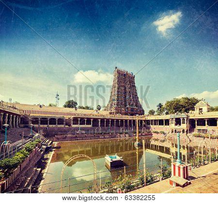 Vintage retro hipster style travel image of Sri Menakshi Temple water tank, Madurai, Tamil Nadu, India with grunge texture overlaid