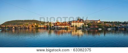 Panorama of Prague: Gradchany (Prague Castle), St. Vitus Cathedral and Charles Bridge over Vltava river on sunset, Prague, Czech Republic