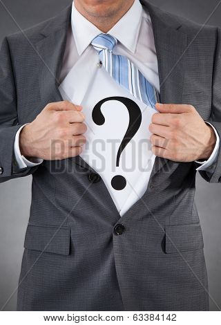 Businessman With Question Mark Sign