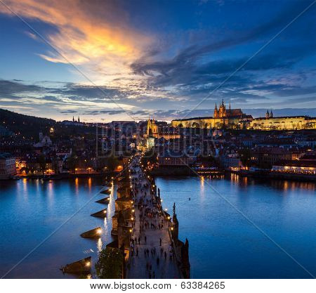 Night aerial view of Prague castle and Charles Bridge over Vltava river in Prague, Czech Republic. Prague, Czech Republic