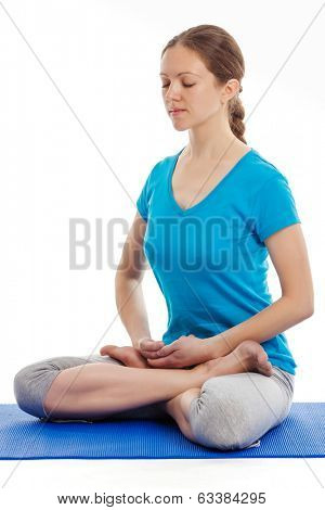 Yoga - young beautiful woman yoga instructor doing Lotus Position (padmasana with bhairava mudra) asana exercise - cross-legged sitting asana for meditation - isolated on white background
