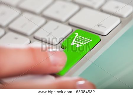 Hand On Green Shopping Cart Button