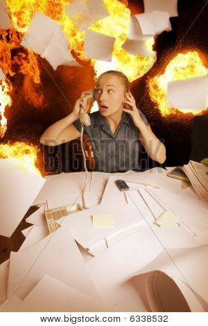 office on fire and flying paper sheets