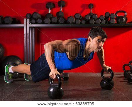 Kettlebells push-up man strength pushup exercise workout at gym