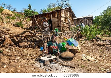 Woman Preparing Food - Injera .