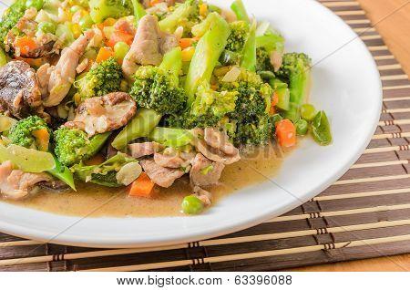 Stir fried Broccoli Carrot Sweet corn Green Bean and Onion with pork. Vegetarian food