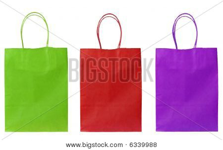 Three cheerful shopper bags - isolated on white