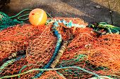 image of fishnet  - Fishing net orange fishnet white yellow float outdoor