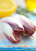 foto of endive  - fresh and ripe red endive with rosemary and lemon - JPG