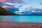 picture of incredible  - Beautiful dramatic sunset over the incredibly blue lake Tekapo with mountains - JPG