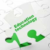 Education concept: Education Technology on puzzle background