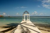stock photo of gazebo  - palm tree shadow over gazebo in Caribbean in Montego Bay - JPG