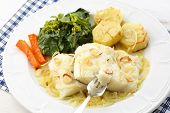 roasted fresh cod fillet with cabbage and potatoes-traditional portuguese dish