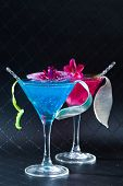 Molecular mixology - Blue swimming pool Cocktail with caviar and flower petals