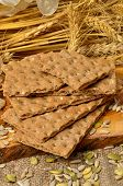 stock photo of hardtack  - Cereal crackers and seed on the kitchen